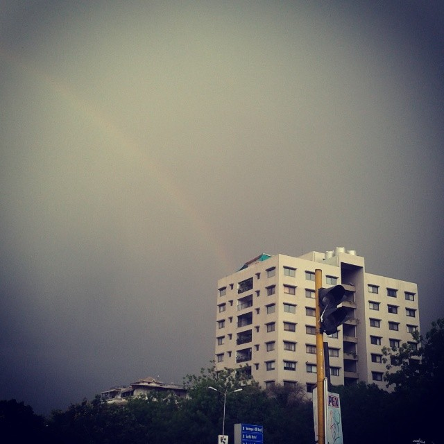 Rainbow evenings in May. #ahmedabad #rain #windy #dreary #rainbow